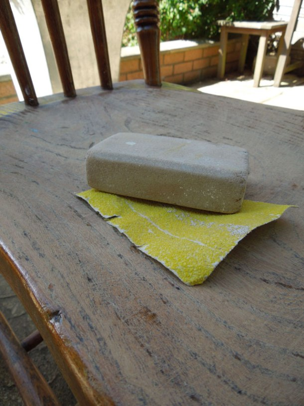 Rub down using a course sandpaper and lots of elbow gease!